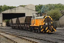 A diesel locomotive with tiger stripes HNRC 30 at Lafarge Hope Cement Works 2.jpg
