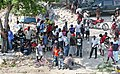 Haitians wait for Marines to land (4295289121).jpg