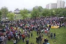 A crowd gathered in a large field