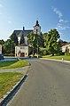 Hasičská zbrojnice a kostel Nanebevzetí Panny Marie - pohled z návsi, Slatinice, okres Olomouc.jpg