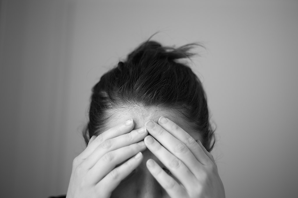Headache_touching_forehead