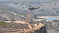 Helicopter over Għajn Tuffieħa Tower.jpg