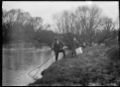 Henry Gurr and his son whitebaiting on the Taieri River. ATLIB 294710.png