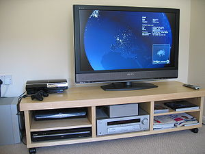 Home cinema - A mid-level home theater system consisting of large-screen LCD television, a Sky+ HD satellite TV box, and a DVD player (and a Blu-ray Disc-capable PlayStation 3 game console). The equipment is on a TV stand.