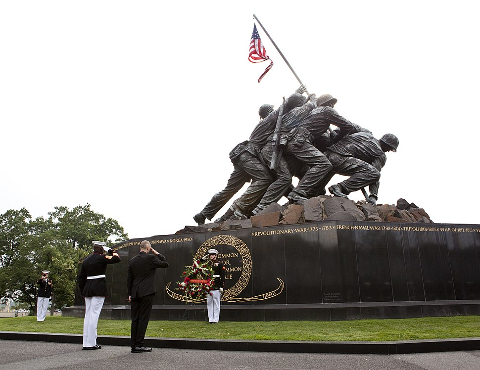 Honorary Marine Daran Wankum, third from left, salutes during a wreath laying ceremony at the Marine Corps War Memorial in Arlington, Va, June 13, 2013 130613-M-KS211-013