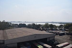Rani Gunj - Hussain Sagar as seen from James Street railway station in Hyderabad, India. Seen in the foreground is Ranigunj Bus Depot.