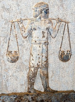 An Indian tribute-bearer at Apadana, from the Achaemenid satrapy of Hindush, carrying gold on a yoke, circa 500 BC. Indian gold tribute donor Apadana.jpg