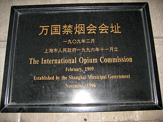 International Opium Commission - A plaque which commemorates International Opium Commission, outside of the Peace Hotel on the Bund.