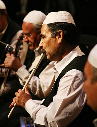 Arabic musical instruments - Traditional flute player from Iraqi folk troupe