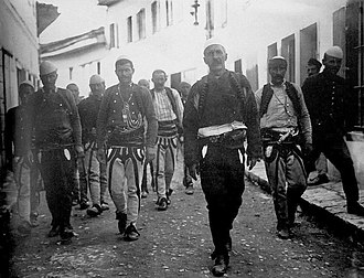 Independent Albania - Isa Boletini with men from Kosovo in the streets of Vlorë in 1912