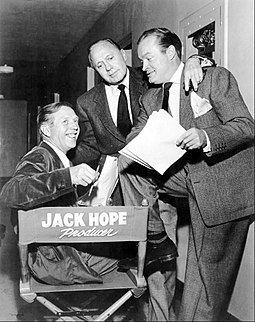 Hope (right) with his brother Jack (seated), who produced his early 1950s show, with comedian Jack Benny Jack Hope Jack Benny Bob Hope 1954.JPG
