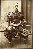 Japanese warrior in armor. (10797305704).jpg