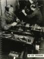 Jewish men working at a lathe.png