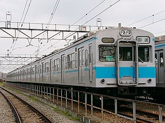 103 series - Revised livery with light blue stripe, May 2003
