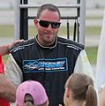 Johnny Sauter interacting with fans at Wisconsin International Raceway 2014.jpg