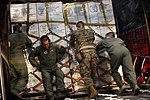 Joint forces work together to help those affected by Super Typhoon Haiyan (10961902915).jpg