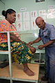 Jospeh Sodiasi fitting a patient Vele who lost her leg to diabetes at the National Orthotic & Prosthetic Services (NOPS), Port Moresby General Hospital, PNG. (10705900644).jpg