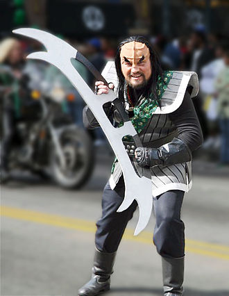 Bat'leth - A person in a Klingon costume with a bat'leth