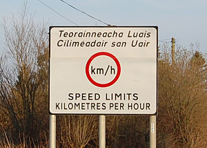 Republic of Ireland–United Kingdom border - A bilingual traffic sign in County Louth, in Ireland, warning drivers travelling south across the border that metric speed limits are used in Ireland, whereas the United Kingdom uses imperial units.