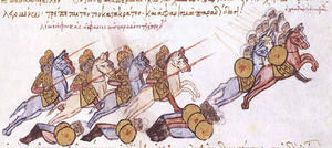 Medieval miniature showing a group of lance-wielding cavalry to the left pursuing a group of riders wearing turbans and carrying round shields to the right