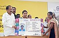 M. Venkaiah Naidu and the Union Minister for Textiles, Smt. Smriti Irani giving the Artisan Identity Card to handloom weavers under the Hathkargha Samvardhan Sahayatha Scheme, at the Swarna Bharat Trust, in Atkur, Vijayawada (1).jpg