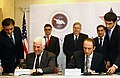 MCC CEO Ambassador John Danilovich and Prime Minister Grigol Mgaloblishvili sign the Compact Amendment document (Tbilisi, Georgia, November 20, 2008).jpg