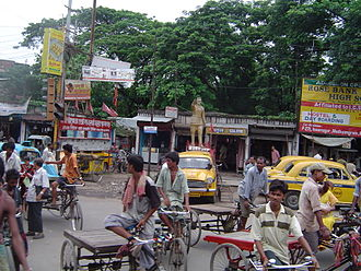 """Madhyamgram -  Madhyamgram Crossing on Jessore Road; traffic jam, including the """"cycle-van""""s"""