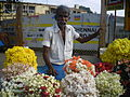 Man in flower stall.JPG