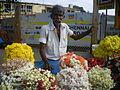 Man in flower stall.JPG