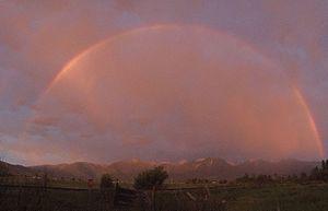 Arlee, Montana - Rainbow over McLeod Peak looking east across Jocko Valley