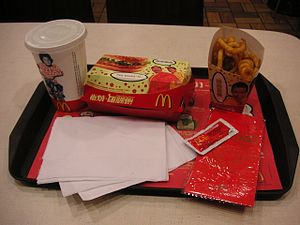 International availability of McDonald's products - McDonald's Chinese New Year meal, grilled chicken sandwich and twisted French fries. Tray liner has an image of the Chinese zodiac.
