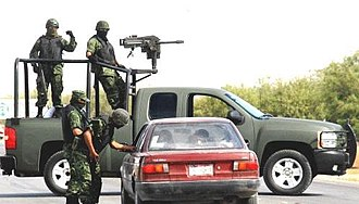 Mk 19 grenade launcher - Image: Mexican troops operating at a random checkpoint 2009