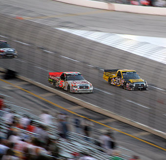 Mike Skinner racing Todd Bodine in the Texas Craftsman Truck Series race. MikeSkinnerBattlingToddBodine.jpg