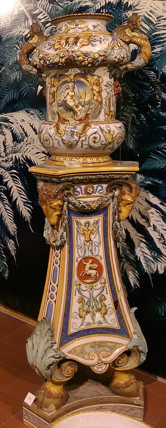Victorian majolica - Minton tin-glazed Majolica flower pot and stand imitating Italian Renaissance maiolica process and 'grotesque' style. Potteries Museum, Stoke-on-Trent, UK