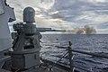 Mk 38 Mod 2 chain gun of USS Mustin (DDG-89) firing during gunnery exercise in South China Sea US Navy 150526-N-ZZ786-203.jpg