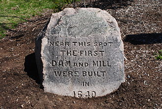 Mother Brook - A stone from 1886 marking the location of the first mill built on Mother Brook