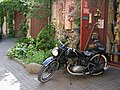 Motorcycle in the Courtyard (4776495007).jpg
