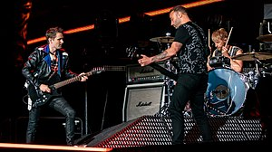 Muse performing in 2019. From left to right: Matt Bellamy, Chris Wolstenholme, Dominic Howard