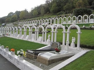 Aberfan disaster - The white arches in Bryntaf Cemetery, Aberfan, which mark the graves of children killed in the disaster.