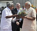 Narendra Modi being welcomed by the Governor of Kerala, Justice (Retd.) P. Sathasivam, the Chief Minister of Kerala, Shri Oommen Chandy, on his arrival at Kozhikode Airport, in Kerala on February 02, 2016 (1).jpg