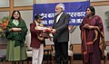 Narendra Modi conferring the National Awards for Bravery 2014 to Gunjan Sharma from Assam who displayed tremendous bravery & saved fellow school students from abductors.jpg