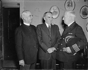 75th United States Congress - Washington, D.C., March 25, 1937: Navy Chaplain Edward Duff opens the House of Representatives with a prayer for the first time since 1820. It was the first time in 117 years that the Navy was again honored in giving the invocation. Left to right: James S. Montgomery, Chaplain of the House; Speaker William Bankhead; and Capt. Edward A. Duff, Chief of Chaplains U.S. Navy