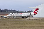 """Network Aviation (VH-NHP) Fokker 100, in new QantasLink """"new roo"""" livery, at Wagga Wagga Airport (1).jpg"""