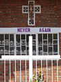 Never Again - With Display of Skulls of Victims - Courtyard of Genocide Memorial Church - Karongi-Kibuye - Western Rwanda - 03.jpg