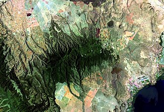 Ol Doinyo Eburru - Landsat image of Eburru. Lake Naivasha in lower right. Lava flows of the Elmenteita Badlands at the top-center