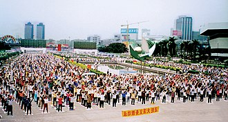 New religious movement - Practitioners of Falun Dafa perform spiritual exercises in Guangzhou, China.