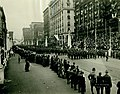 Parade of the 138th Infantry down Twelfth Street, past the Court of Honor reviewing stands. 9 May 1919.jpg