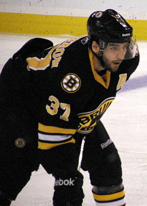 "Third jersey - Patrice Bergeron in all black Bruins third jersey in 2011, with exchanged  ""spoked-B"" and shield logo locations"