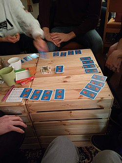 People playing board game card game in circle.jpg