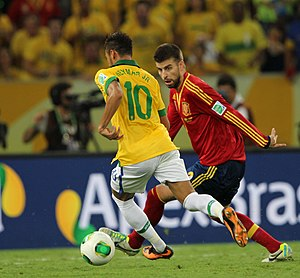 Gerard Piqué - Piqué in action for Spain at the FIFA Confederations Cup in 2013 with then-FC Barcelona teammate Neymar.